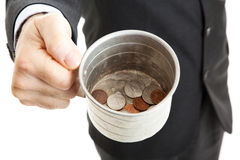 Bad Economy - Begging for Change. Closeup of a businessman with a tin cup, begging for change.  White background Stock Photos