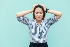 Bad emotions and feelings concept. Headache. Business woman touc. Hing head and have a migraine. Outdoor shot Stock Photo