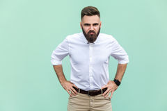 Bad emotions and feelings. Serious man, angry look at camera over light green background Stock Photos