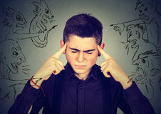 Bad evil men pointing at stressed man. Desperate guy having headache Stock Photos