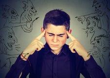 Bad evil men pointing at stressed man. Desperate guy having headache stock photos