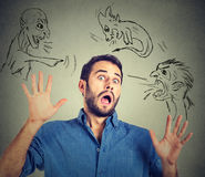 Bad evil men pointing at stressed man. Desperate scared young businessman Stock Photo
