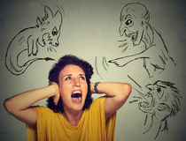 Bad evil men pointing at stressed woman Stock Photo