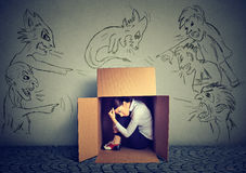 Bad evil men pointing at woman. Girl hiding inside box Royalty Free Stock Photo