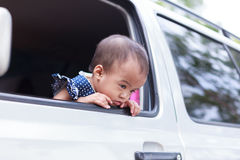 Bad feeling baby out of window Royalty Free Stock Photography