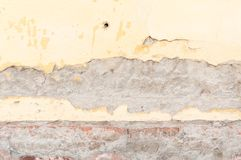 Bad foundation base on old house or building cracked plaster facade wall with brick background Stock Image