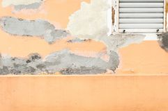 Bad foundation base on old house or building cracked plaster facade wall with brick background Royalty Free Stock Image