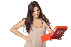 Bad gift. Pretty girl is not happy and is disgusted from her gift Stock Photos
