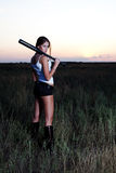 Bad girl. The bad girl costs with a baseball bat, in a grass Stock Images