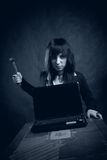 Bad girl. Bad furious girl about to crush notebook Royalty Free Stock Photos