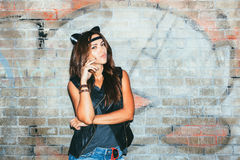 Bad girl with leather cat ears. Bad girl  with leather cat ears. Urban scene. Outdoor lifestyle portrait Royalty Free Stock Image