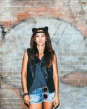 Bad girl with leather cat ears. Bad girl  with leather cat ears. Urban scene. Outdoor lifestyle portrait Royalty Free Stock Photography