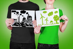 Bad and good concept of ecology. Couple holding  the list with concept of ecology Royalty Free Stock Images