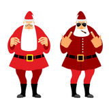 Bad and  good Santa Claus. Wicked Christmas Santa with igaretoj, Royalty Free Stock Photos
