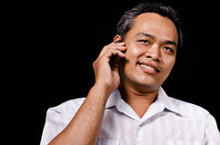 Bad guy. In Insincered look talking on the phone stock photography
