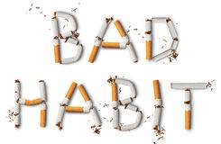 Bad Habit. Text ''Bad Habit'' made from broken cigarettes stock photos