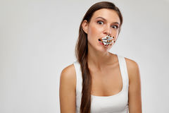 Bad Habit. Young Woman With Bunch Of Cigarettes In Mouth. Bad Habit. Closeup Of Beautiful Girl Holding Lots Of Cigarettes In Mouth On White Background. Portrait stock photos