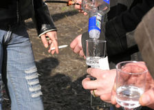 Bad Habits. Hands with cigarette and cups of vodka. alcohol abuse and smoke (bad habits Stock Image