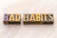 Bad habits word abstract in wood type. Bad habits - word abstract in vintage letterpress wood type printing blocks Royalty Free Stock Photos