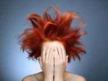 Bad hair day. Redhead with messy hair covering her face with hands royalty free stock photos