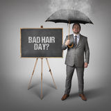 Bad hair day text on blackboard with businessman Royalty Free Stock Photos