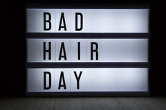 Bad hair day. `Bad hair day` text in lightbox Royalty Free Stock Photos