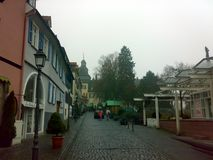 BAD HOMBURG, GERMANY - DECEMBER 28, 2007: Architecture and people on the streets city. BAD HOMBURG, GERMANY - DECEMBER 28, 2007: Architecture and people on the stock photo