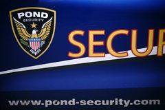 Pond Security Service. Bad Homburg, Germany - May 19, 2018: The blue-painted car door of a Pond Security Services emergency vehicle with coat of arms on May 19 Royalty Free Stock Images