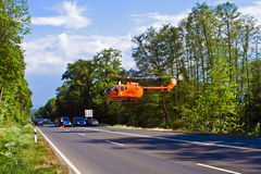 Rescue helicopter is on duty. BAD HOMBURG, GERMANY - May 05: Helicopter is landing on the street to save and transport a seriously insured person by car accident Stock Photography