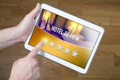 Bad hotel review. Disappointed and dissatisfied customer. stock photo