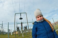 Girl standing near a power station, bad influence on people concept stock images