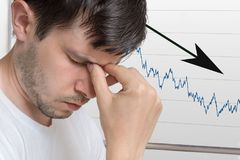 Bad investment or economic crisis concept. Man is disappointed from recession royalty free stock photos