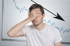 Bad investment or economic crisis concept. Man is disappointed from recession royalty free stock images
