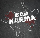 Bad Karma Chalk Outline Dead Body Violent Reaction Poor Treatmen. Bad Karma words on a chalk outline of a dead or murdered body to illustrate someone who has Stock Photography