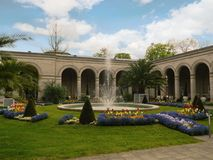 Bad Kissingen, Bad Kissingen District, Lower Franconia, Bavaria, Germany - May 11 2017: Famous Arcade building with arcade passage. And spa garden park Stock Image