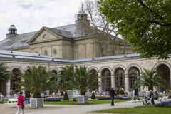 Bad Kissingen, Bad Kissingen District, Lower Franconia, Bavaria, Germany - May 11 2017: Famous Arcade building with arcade passage. And spa garden park Stock Photography