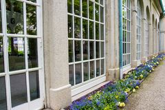 Bad Kissingen, Bad Kissingen District, Lower Franconia, Bavaria, Germany - May 11 2017: Famous Arcade building with arcade passage. And spa garden park Royalty Free Stock Photography