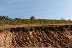 Bad land. Landslide or damaged landscape of mud deeply cracked by erosion of the rain royalty free stock image