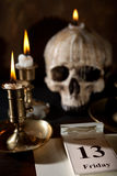 Bad luck on Friday 13th. Friday 13th on a calendar with candles and a creepy skull royalty free stock image