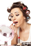 Bad makeup. Girl with curlers and bad makeup outlining the lips Stock Images