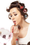 Bad makeup. Girl with curlers and bad makeup outlining the lips Stock Image