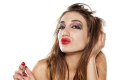 Bad makeup. Young beautiful woman with bad makeup making duck face Stock Image
