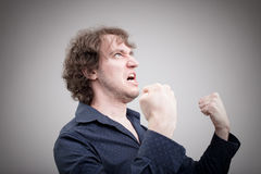 Bad man expressing anger with face and hands Stock Images