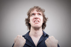 Bad man expressing anger with face and hands Stock Image