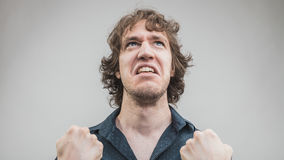 Bad man expressing anger with face and hands Royalty Free Stock Images