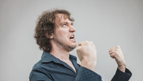Bad man expressing anger with face and hands Royalty Free Stock Image