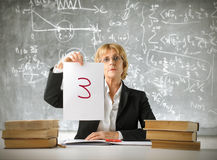 Bad mark. Severe teacher showing a bad mark in a classroom stock photo