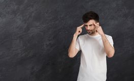 Stressed man whit bad memory trying to concentrate. Bad memory concept. Stressed young man trying to concentrate and remember something Stock Photo