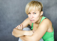 Bad mood. Portrait of young disappointed woman in bad mood royalty free stock photo
