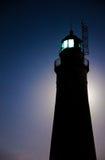 Bad Moon Rising. The Fort Gratiot Lighthouse backlit by the full moon rising. Lighthouse Park. Port Huron, Michigan stock photos